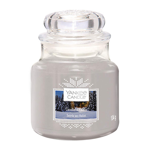 Svíčka ve skleněné dóze Yankee Candle Chata ozářena svíčkou, 104 g